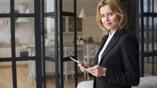 blond-business-woman-using-tablet_23-2148095679